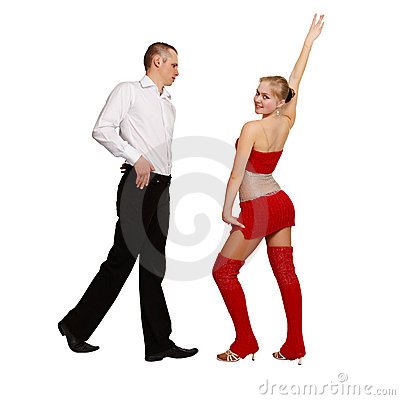 Pair of young people perform ballroom dance