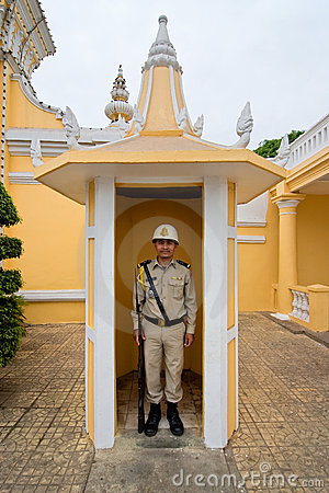 A palace guard at his palace post in Phnom Penh Editorial Stock Photo