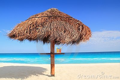 Palapa sun roof beach umbrella in caribbean