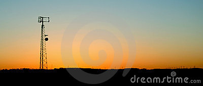 Pale Blue Cell Phone Tower Sunset
