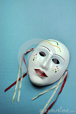 Pale blue ceramic mask. Vertical with copy space.