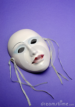 Pale pink ceramic mask. Vertical with copy space.