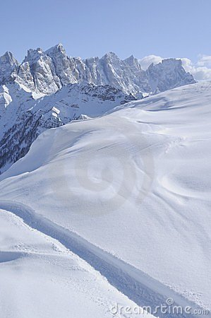 Pale range and snowy slope, dolomites