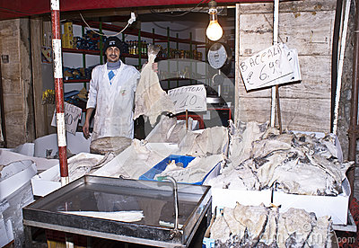 Fishmonger sells cod Editorial Stock Photo