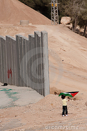 Palestinian Girl and Israeli Separation Barrier Editorial Stock Image