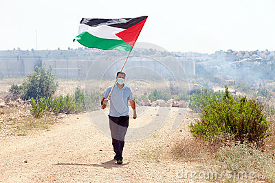 Palestinian Protester Holding Flag by Wall of Separation West Ba Editorial Stock Photo