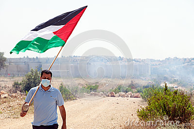 Palestinian Protester Holding Flag by Wall of Separation West Ba Editorial Stock Image