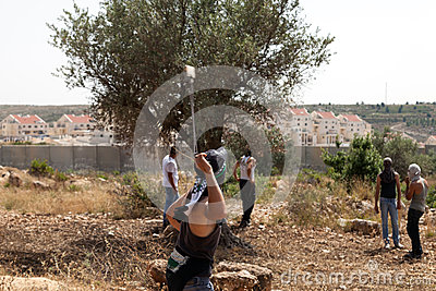 Palestinian Protester Shooting Rock at Protest Editorial Image