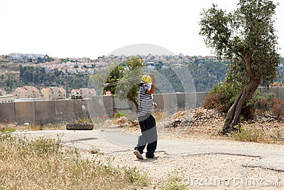 Palestinian Protester Shooting Rock at Protest Editorial Stock Image
