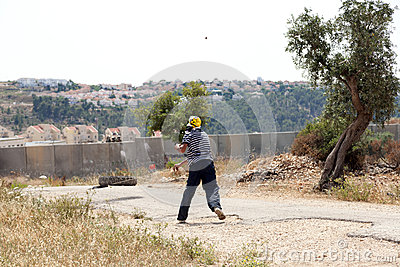 Palestinian Protester Shooting Rock at Protest Editorial Stock Photo