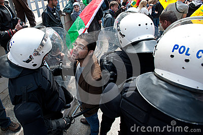 Palestinians face riot police Editorial Stock Photo
