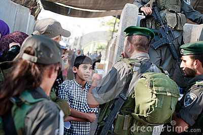 Palestinians at Israeli military checkpoint Editorial Photography