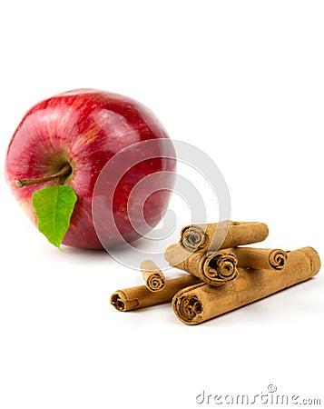 Palillo de cinamomo con la manzana