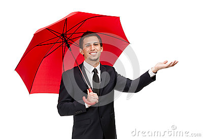 Palming up man with umbrella checks the rain