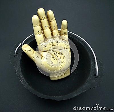 Palmistry hand in cauldron