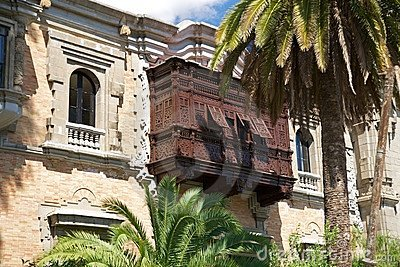 Palms and ancient wood balcony