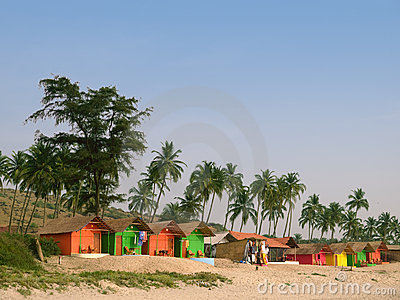 Palms and small guest houses on a beach