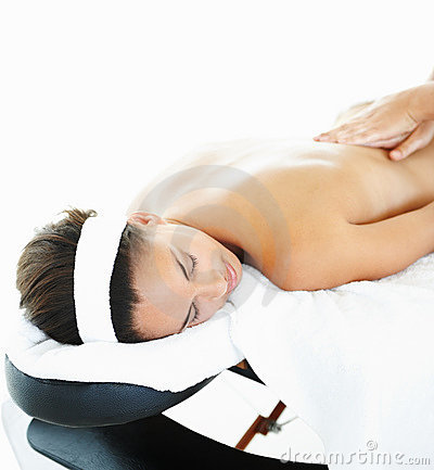 Pampered woman treating herself with a massage