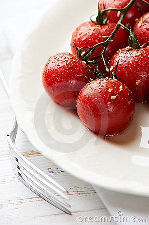 Pan cooked cherry tomatoes on a plate