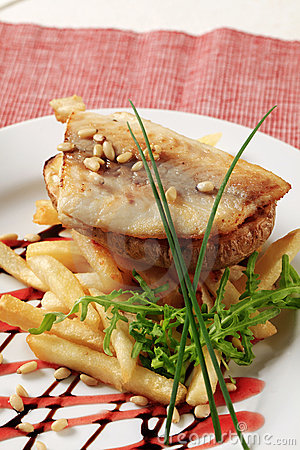 Pan fried fish fillet and fries