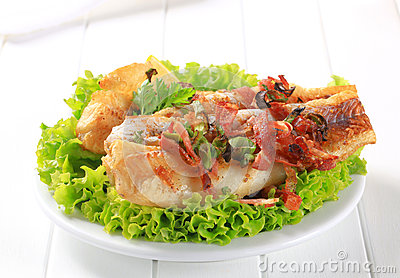 Pan fried fish fillets with bacon bits