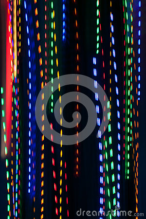 Free Pan Of Colorful Holiday Lights Creates Electric Rain Pattern Royalty Free Stock Image - 49724886