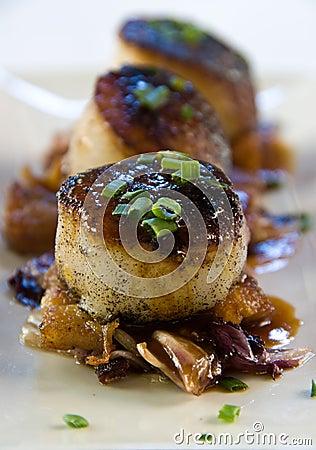 Pan seared scallops over pork belly