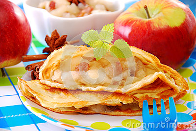 Pancake with apple and raisins for child