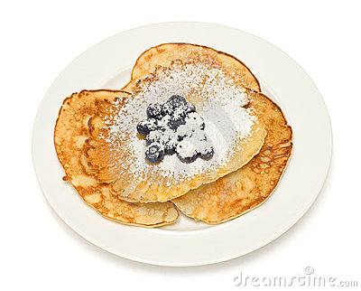 Pancakes with blueberries on white background