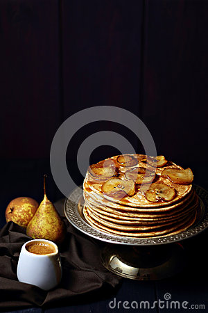 Pancakes with caramelized pears and salted caramel sauce
