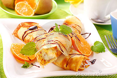 Pancakes with with cottage cheese and orange