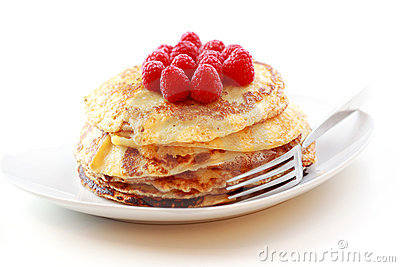 Pancakes with fresh raspberries Stock Photo