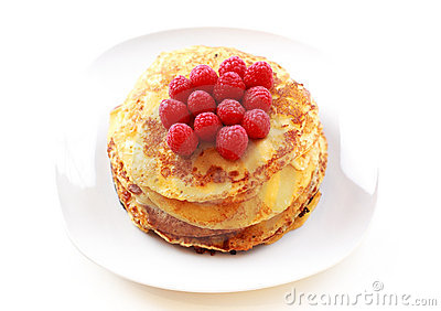 Pancakes with fresh raspberries Stock Photo