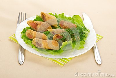 Pancakes with salmon and salad, cutlery