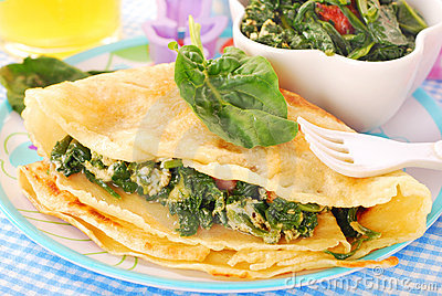 Pancakes with spinach and eggs for child