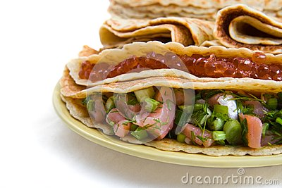 Pancakes with a stuffing from caviar and salmon