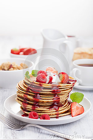 Free Pancakes With Berry And Jam For Breakfast Stock Photo - 35595780
