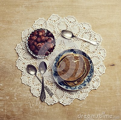 Free Pancakes With Jam On The Old Patterned Napkins On Wooden Table Royalty Free Stock Photo - 48621585