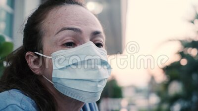 Woman wearing respiratory protective mask stock video footage