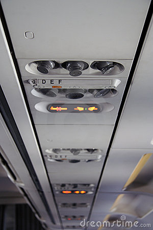 Panel in an airplane above seats