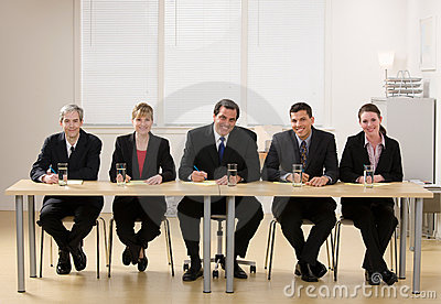 Panel of co-workers about to conduct an interview