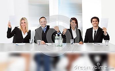Panel judges holding empty score signs