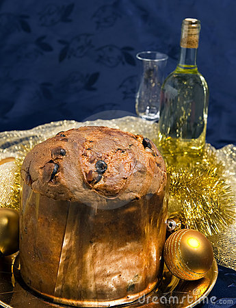 Panettone with wine and Christmas decorations