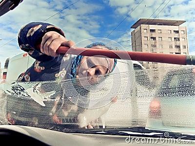 Panhandling window washer Editorial Stock Image
