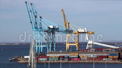 Panning of the cranes and containers at the port of Adelaide, Australia. Adelaide, Australia - March 07, 2020: Panning of the cranes and shipping containers at stock video footage
