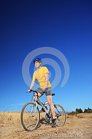 Panning shot of a bicycle rider riding a bike outdoors