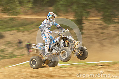 Panning shot of quad rider in jump. Editorial Stock Photo