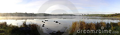 Panorama autumn sunrise on an Irish lake