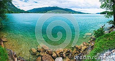 Panorama a blue transparent alpine lake.