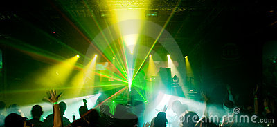 Panorama of a concert in green light
